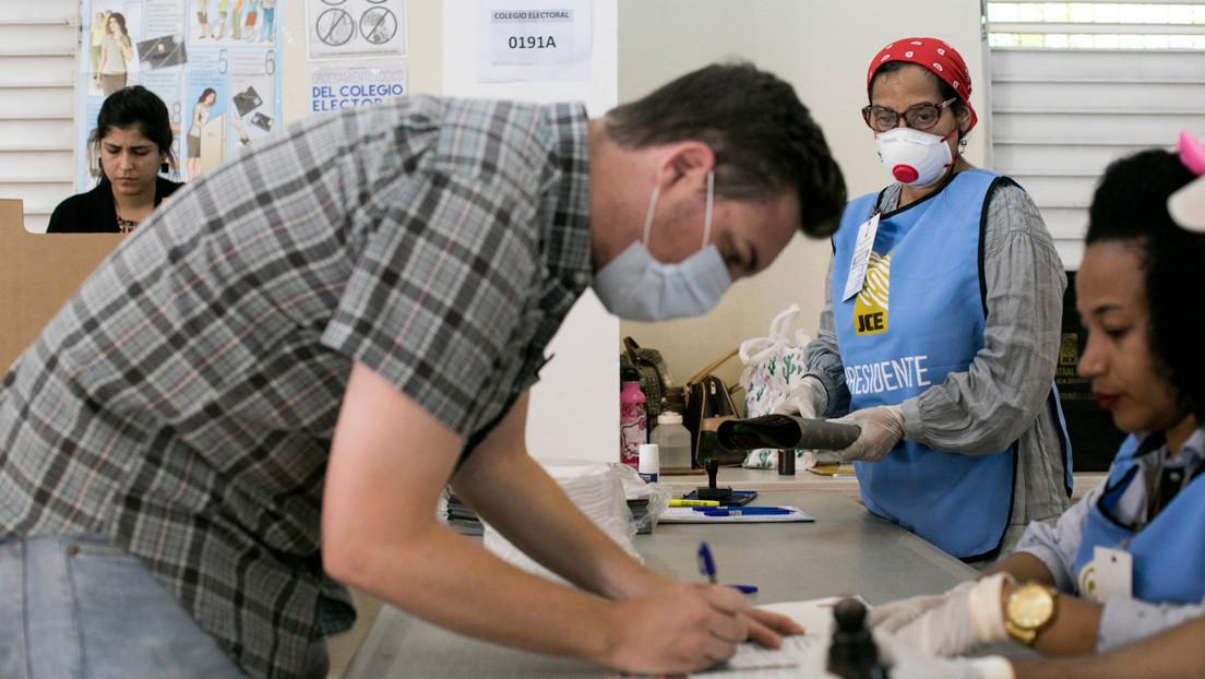 Con tapabocas y distanciamiento social: República Dominicana va a elecciones generales en medio de la pandemia
