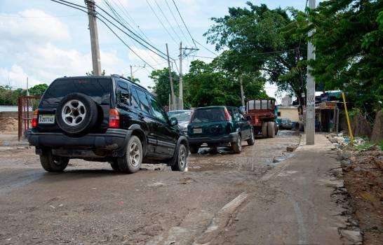 Impotencia e indignación causa mal estado de calle kilómetro 14 de la autopista Duarte