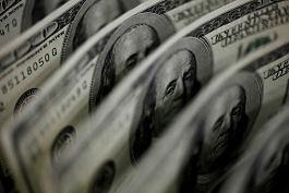 FOREX-Dólar toca mínimos de tres semanas, operadores esperan pistas sobre reducción de estímulos